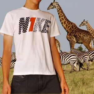 NIKE DRI-FIT multi-patterend logo graphic t-shirt